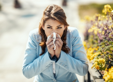 A woman suffers from severe allergy symptoms